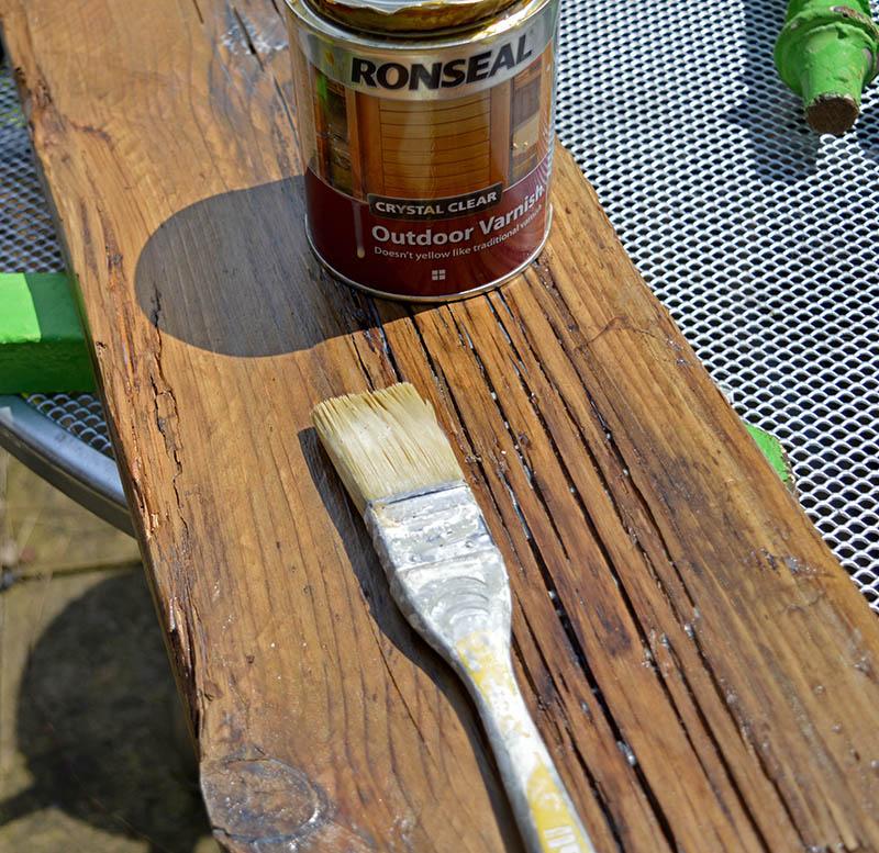 Varnishing scaffolding boards