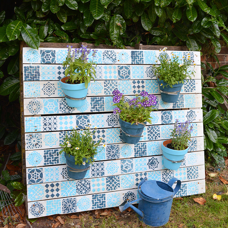 Add some colour to your garden with this stylish affordable Moroccan tile painted pallet wood planter. It's really simple to do full step by step tutorial.
