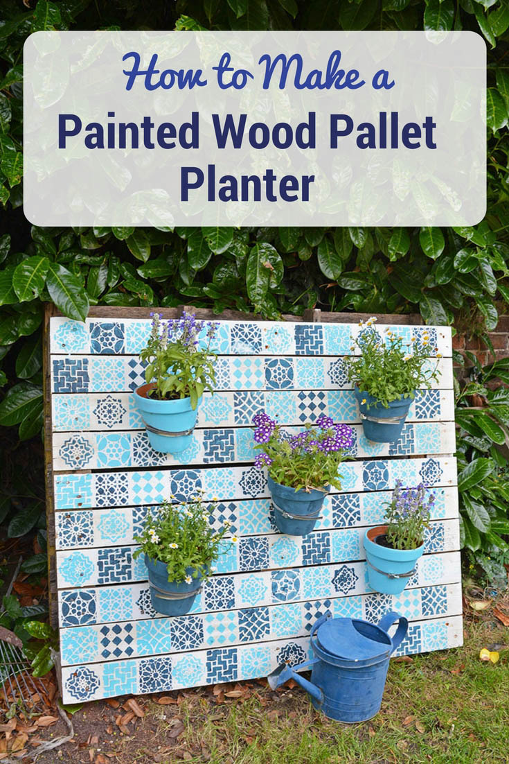 Upcycle an old wood pallet with a moroccan tile stencils, to make an bright painted wood pallet wall planter to add colour to your garden.