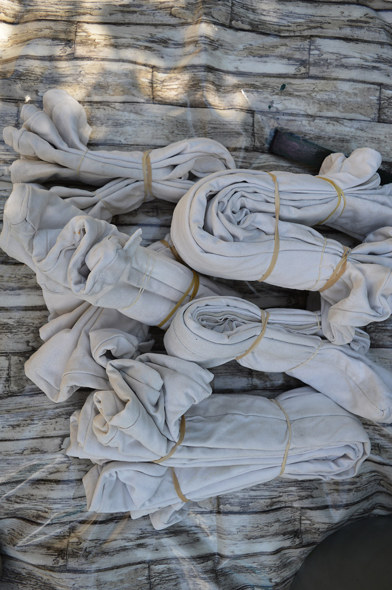 Ikea Ammero cushion covers all folded and tied ready for Shibori dyeing.