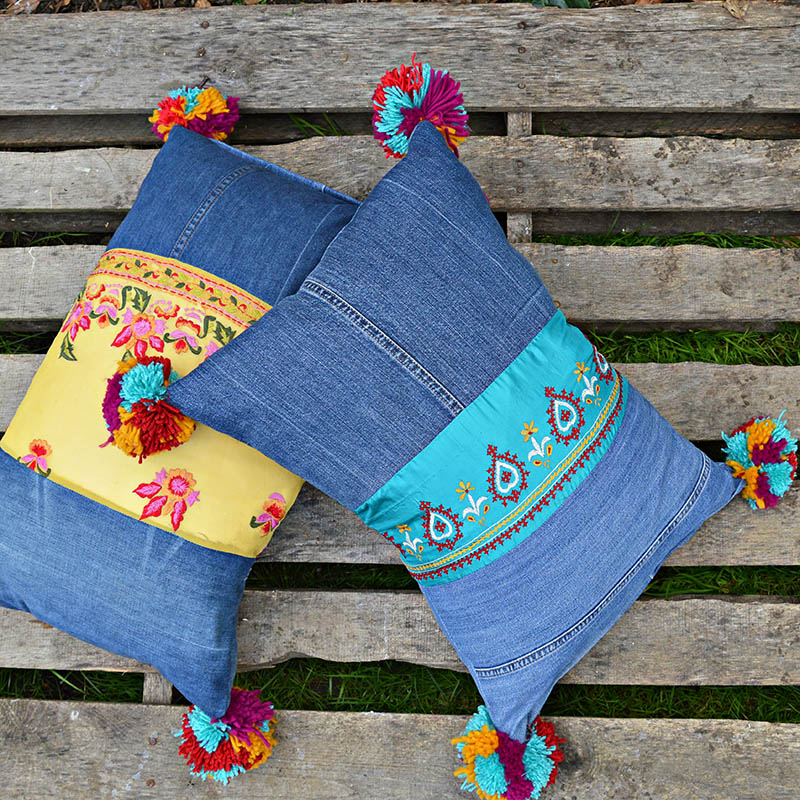 Finished boho style vintage sari trim and recycled jeans pillows with giant pom poms