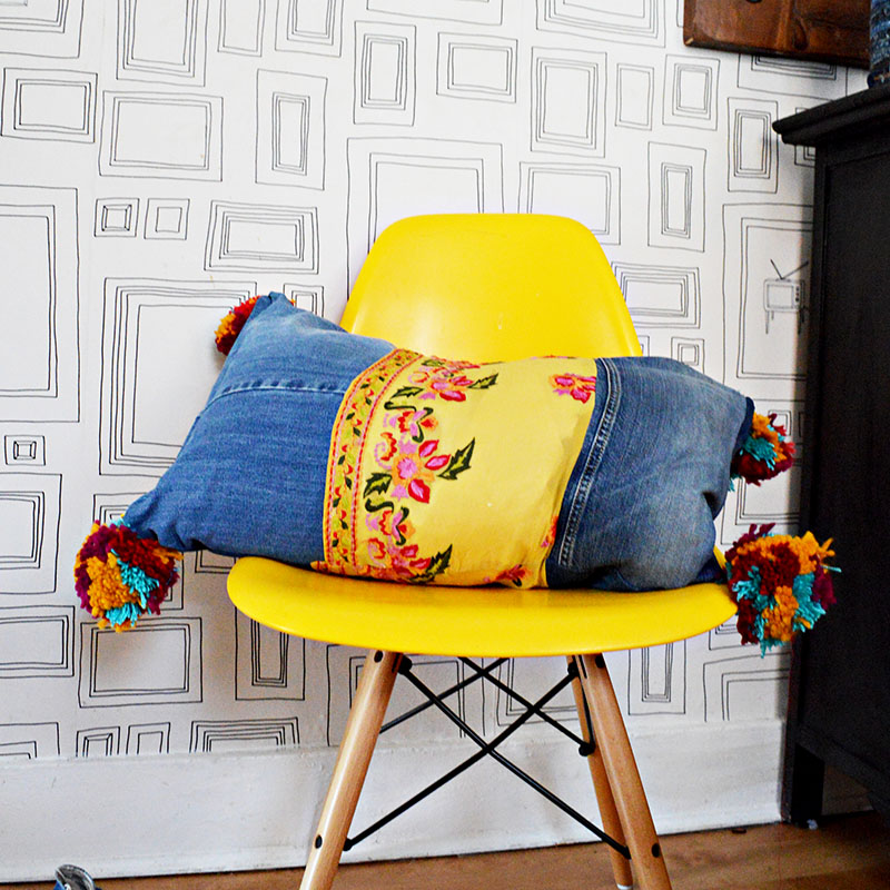 DIY boho style recycled jeans pillows with pom poms and vintage sari trim.