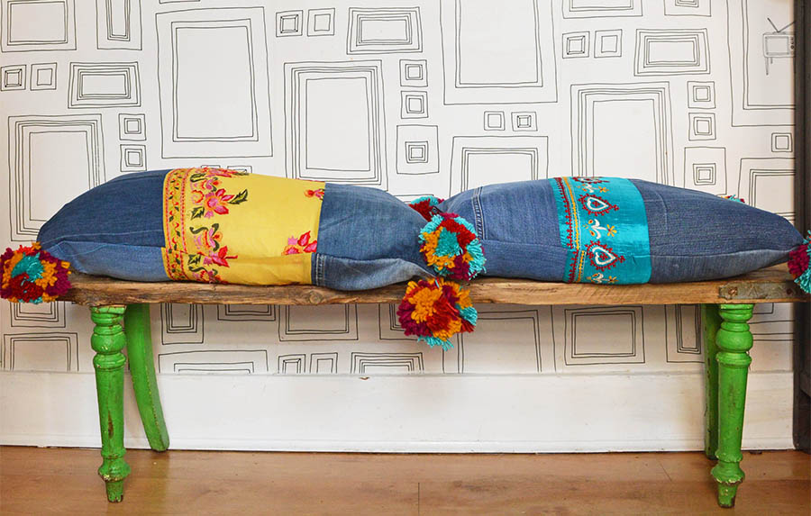 recycled jeans pillows with upcycled denim pom poms and vintage sari trim