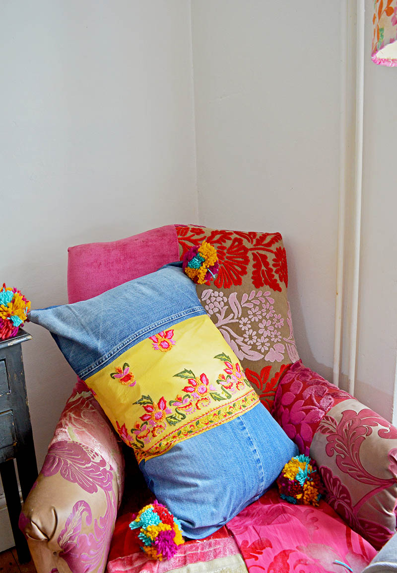 This Boho style recycled jeans pillow will brighten up any home. They made from upcycled denim and have colourful pom poms and sari trim for that boho look.
