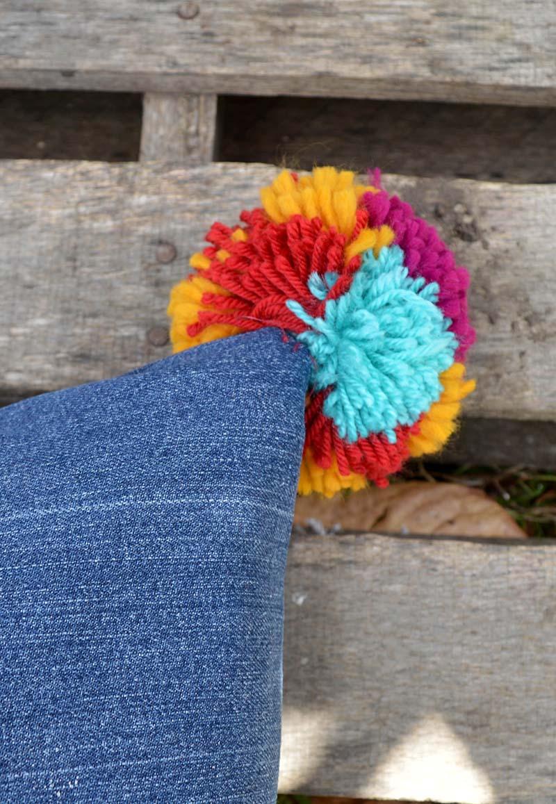 stitching pom pom onto jeans pillows