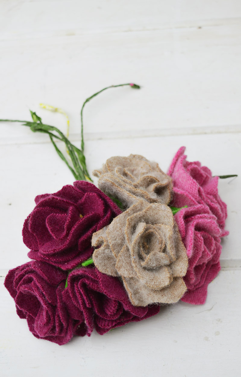 Upcycled felted wool sweater scraps made into felt roses for a gorgeous door wreath decoration.