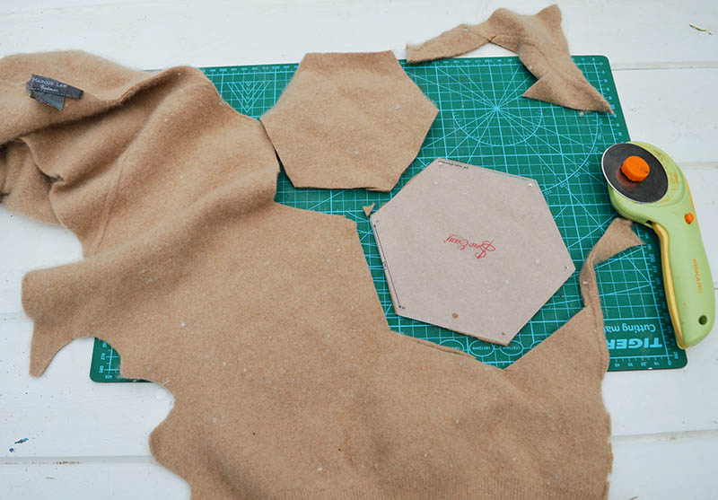 Cutting felt hexagons from upcycled sweaters