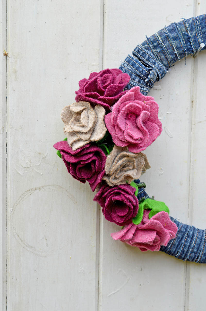 This gorgeous denim wreath is made by using old wool sweaters and recycled jeans seams.  It is very simple to make with a great step by step tutorial.