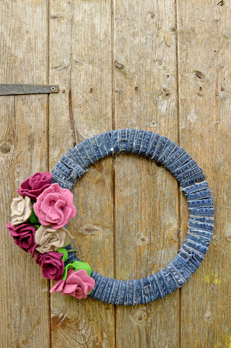 DIY upcycled sweater and jeans into a gorgeous wreath for all seasons.