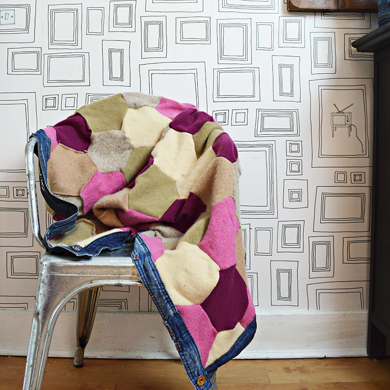 Upcycled sweater blanket with denim waistband trim
