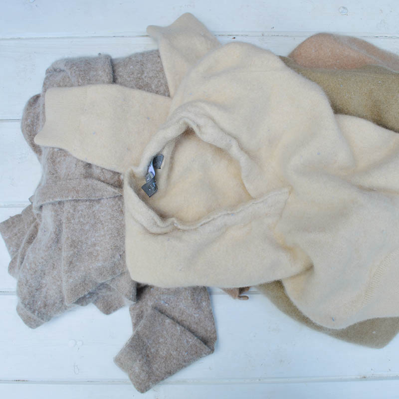 Old wool sweaters for upcycling into a blanket