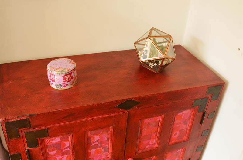 Cabinet upcycle with Annie Sloan's Emperor's Silk chalk paint and Marimekko paper napkins.