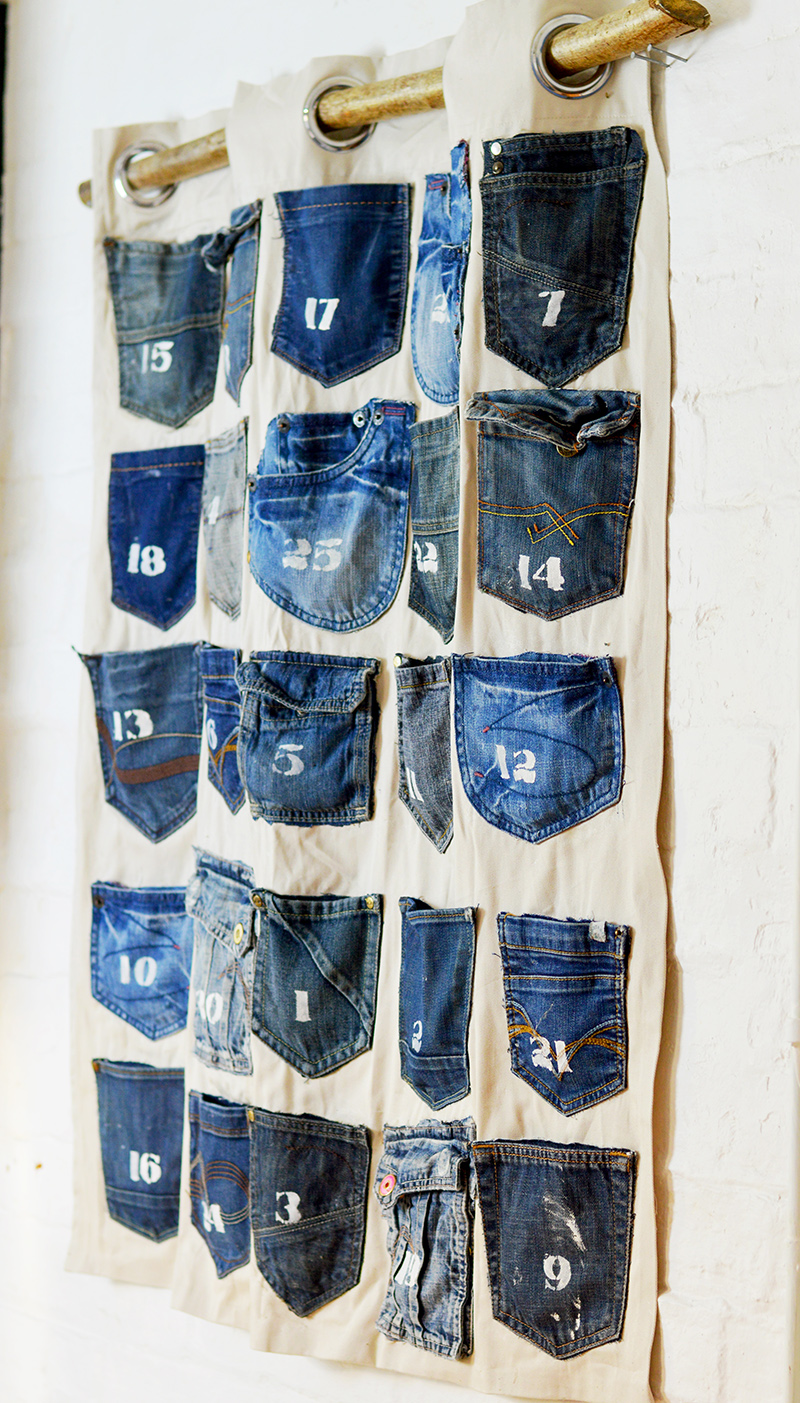 Rustic, industrial homemade advent calendar.  This is easy to make Christmas craft from recycled jeans pockets and is a no-sew project.