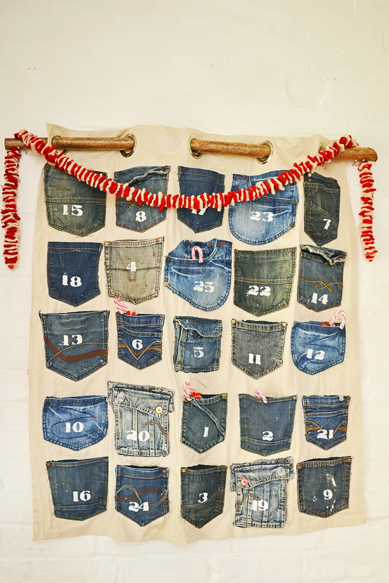 Homemade advent calendar made from the families jeans pockets. A really easy no so rustic Christmas calendar for that farmhouse/industrial look.