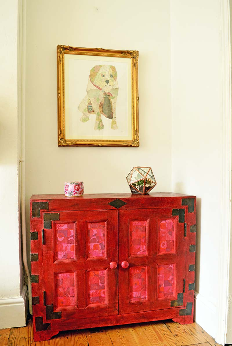 Cabinet upcycle using Annie Sloan Emerpor's Silk red chalk paint and Marimekko paper napkin decoupage.