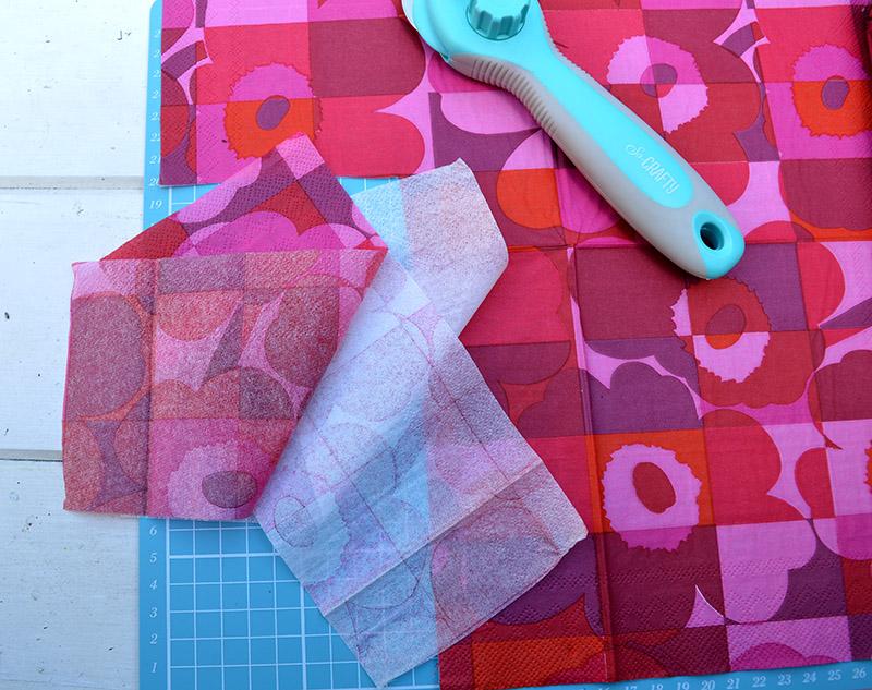 Cutting Marimekko Napkins for decoupage cupboard