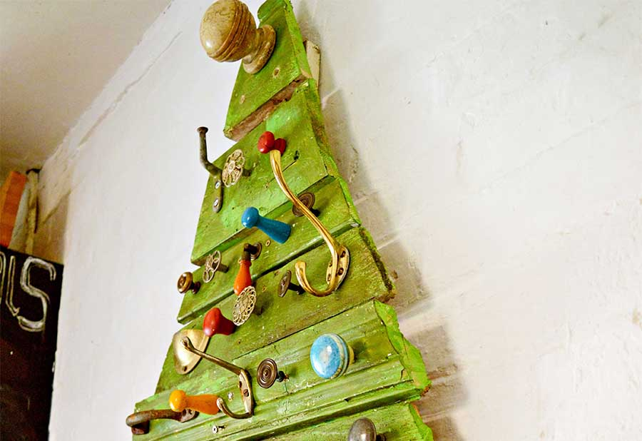 Upcycled flat Christmas tree made from reclaimed wood and cabinet knobs and hooks.