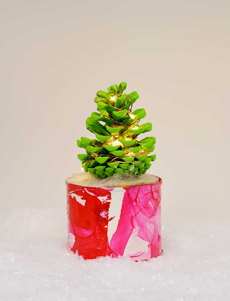 Make a cute colourful illuminated pine cone Christmas tree to brighten up your desk.