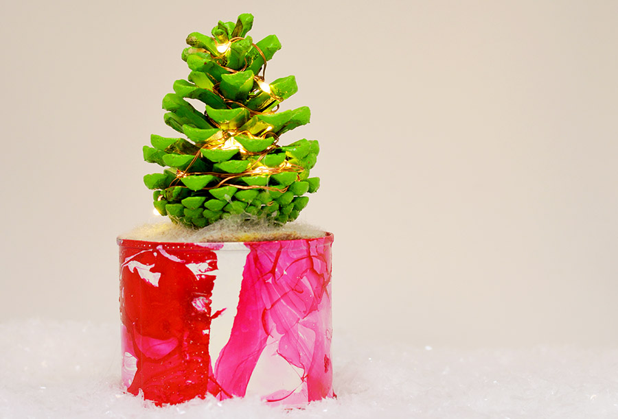 Illuminated DIY mini pine cone Christmas tree for you desk.