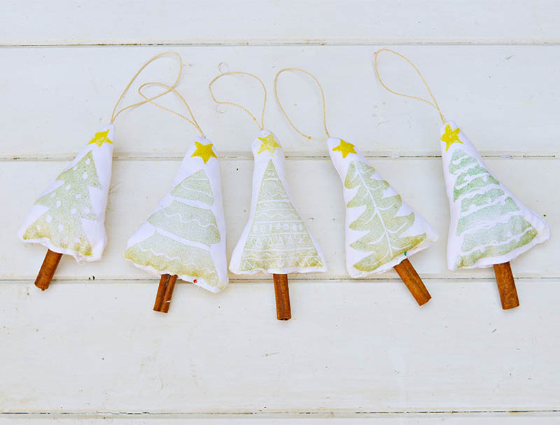 Printed cinnamon Christmas tree decorations made with a handmade Christmas stamp.