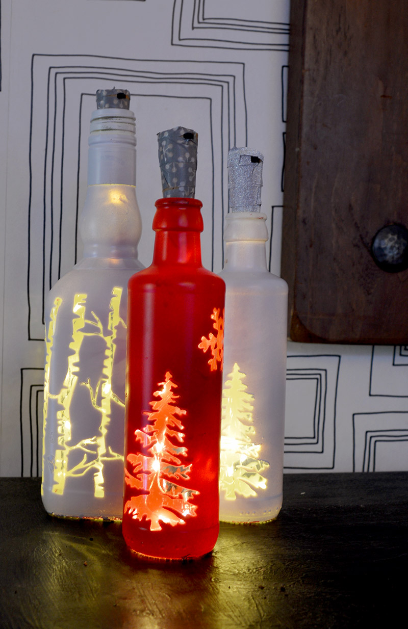 Illuminate your home at Christmas with this simple Christmas bottle lights.  They would also make a lovely Christmas gift. #Christmas #Christmascrafts #Christmaslights #bottlelights #lights