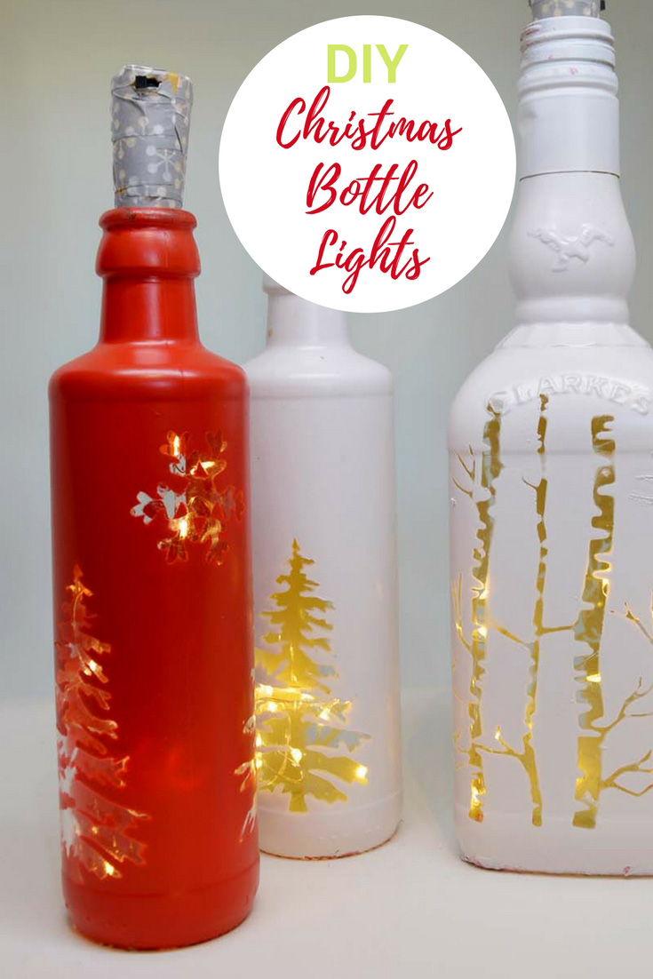 Using cork led lights make some gorgeous Christmas bottle lights to illuminate your home this winter.  So simple no glass drilling required. #Christmas #Christmascrafts #Christmaslights #bottlelights #lights
