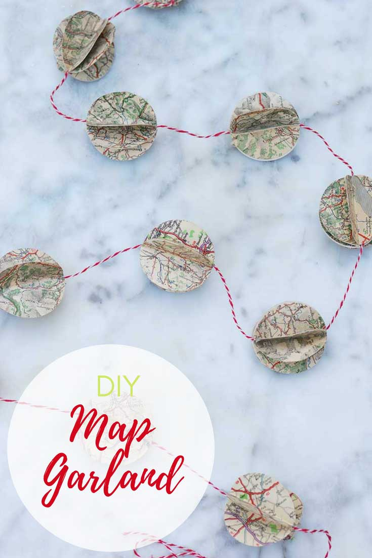 Repurpose and upcycled road maps and atlas's into a gorgeous festive garland.  #christmasgarland #garland #mapcrafts #papercrafts #papergarland #christmascrafts