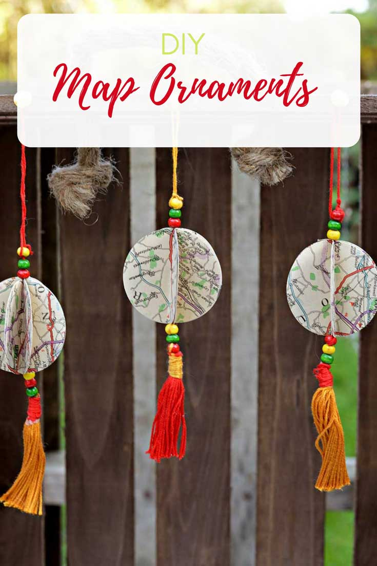Repurpose old road maps into unique personailised Christmas ornaments with tassels.  #christmasdecorations #christmascrafts #christmasornaments #mapcrafts #mapcraft #mapornaments