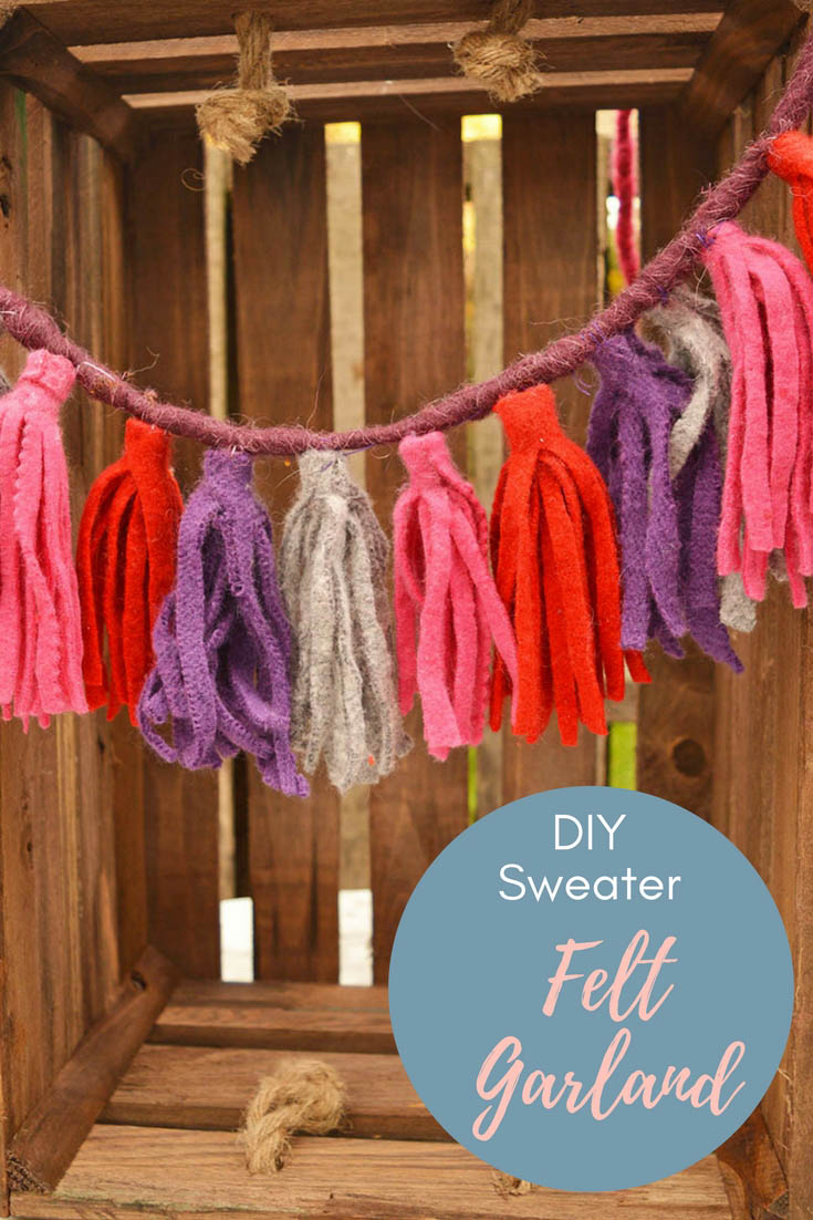 Repurpose sweater scraps into fun felt tassels. They make a lovely keychain or a gorgeous gift topper. Make a few and hang them into a lovely garland. #feltgarland #felt #sweaterupcycle #tassel #felttassel