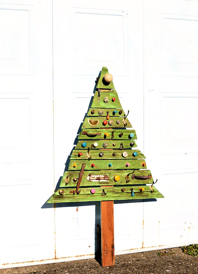 Make a gorgeous flat Christmas tree from upcycled architectural salvage and cabinet knobs and hooks for a unique Christmas decoration.