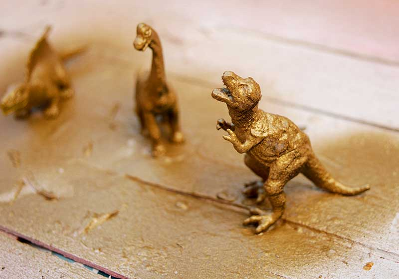 Gold spray painted dinosaur