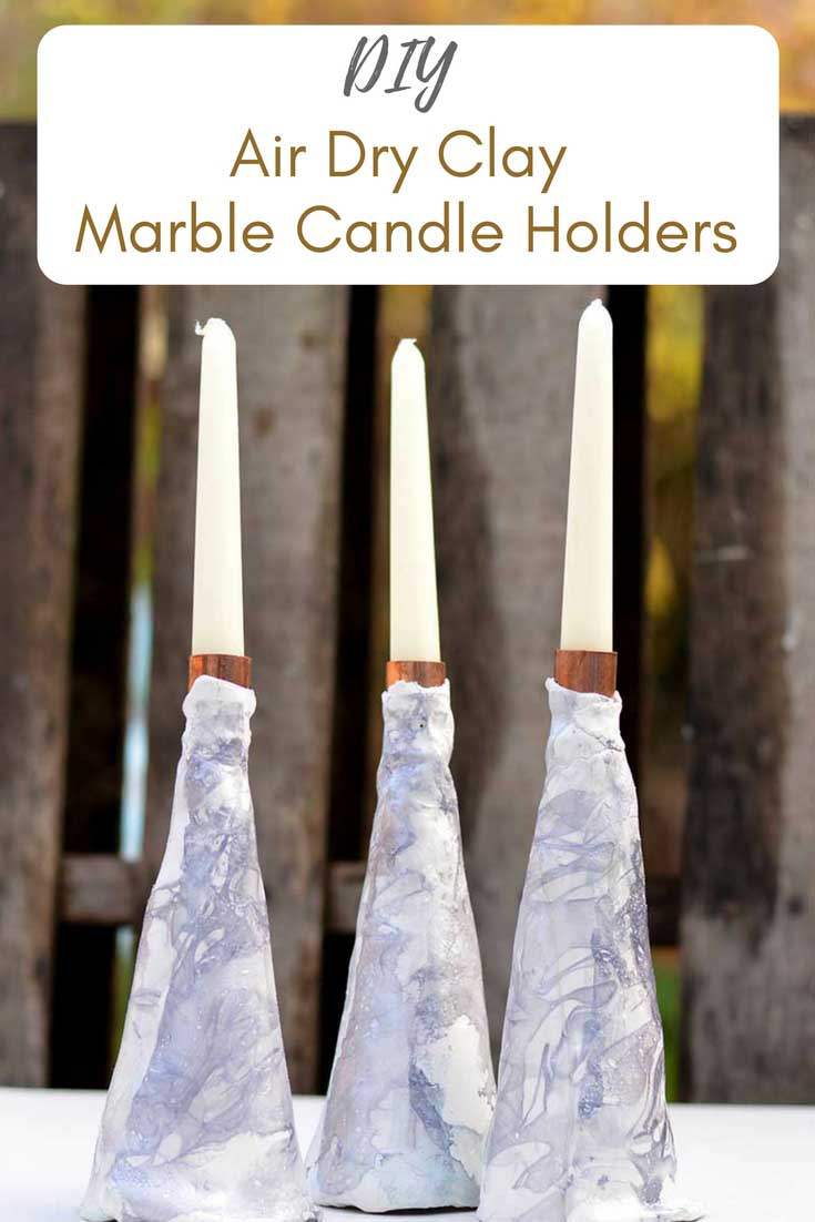 Create a beautiful centerpiece for your Christmas dining table, or an extra decoration for your mantle with an easy to make marble air dry candle holder. #candleholder #airdryclay #claycandleholder #marble