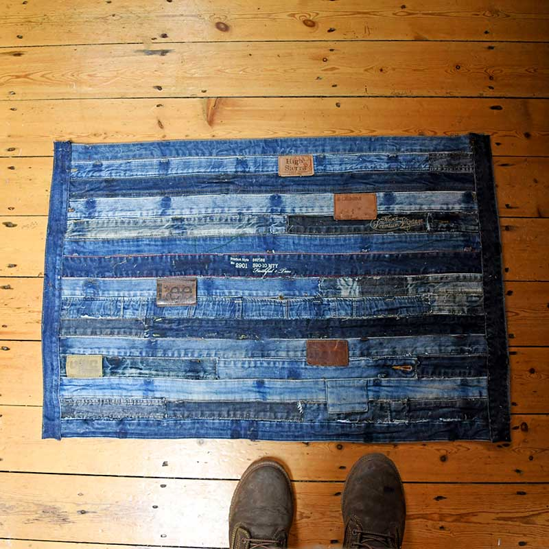 Tutorial for a DIY denim rug made from repurposed jeans waistband-  Ikea hack no sewing.