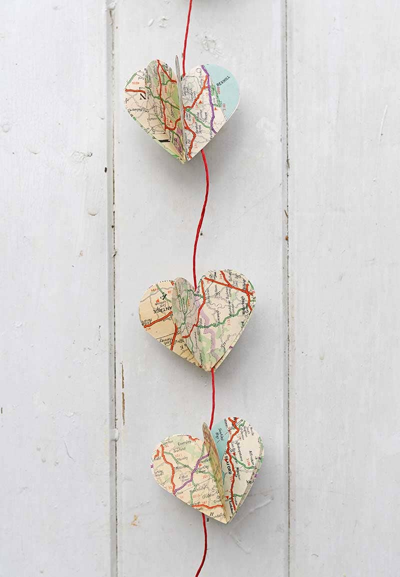 heart garland made from road maps