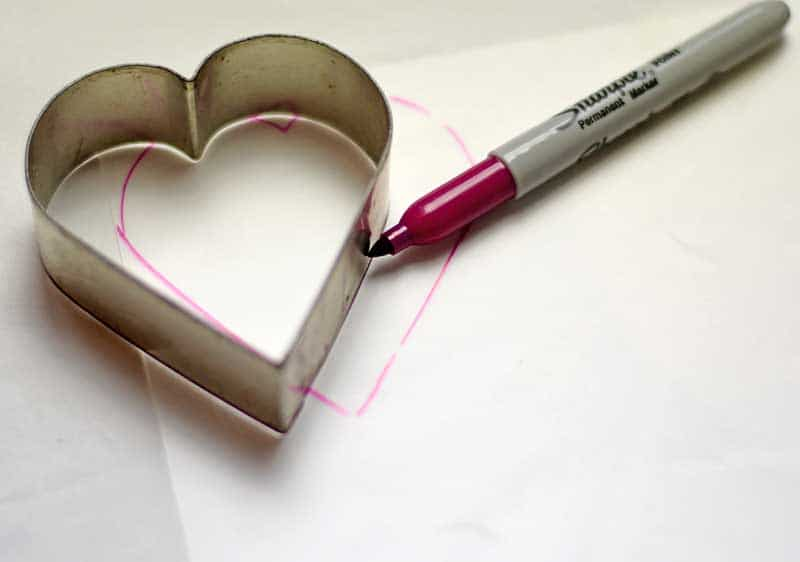 Drawing around heart cookie cutter