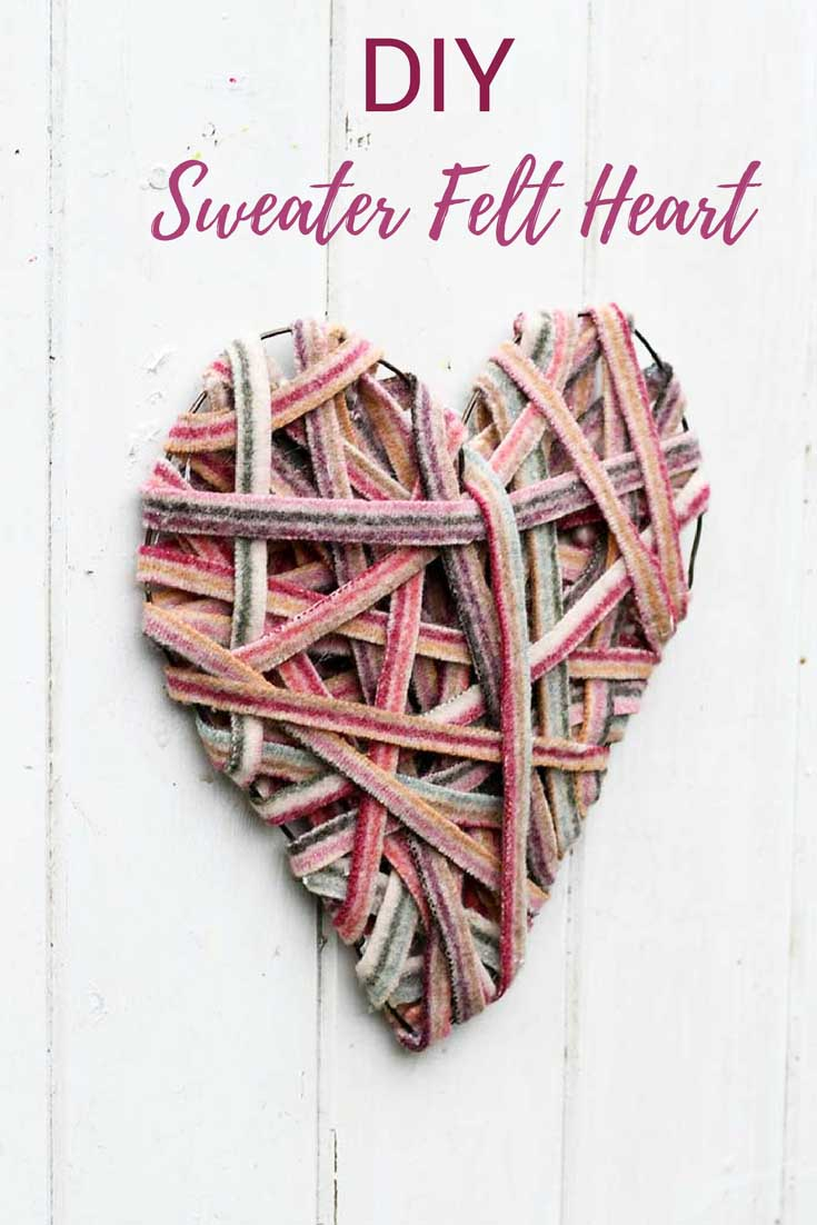 Recycle sweaters into a cute heart decoration for your wall for Valentine's.  A simple, cheap upcycling craft. #recyclesweaters #sweaterfelt #heartdecoration #valentinescraft  #valentinedecoarion