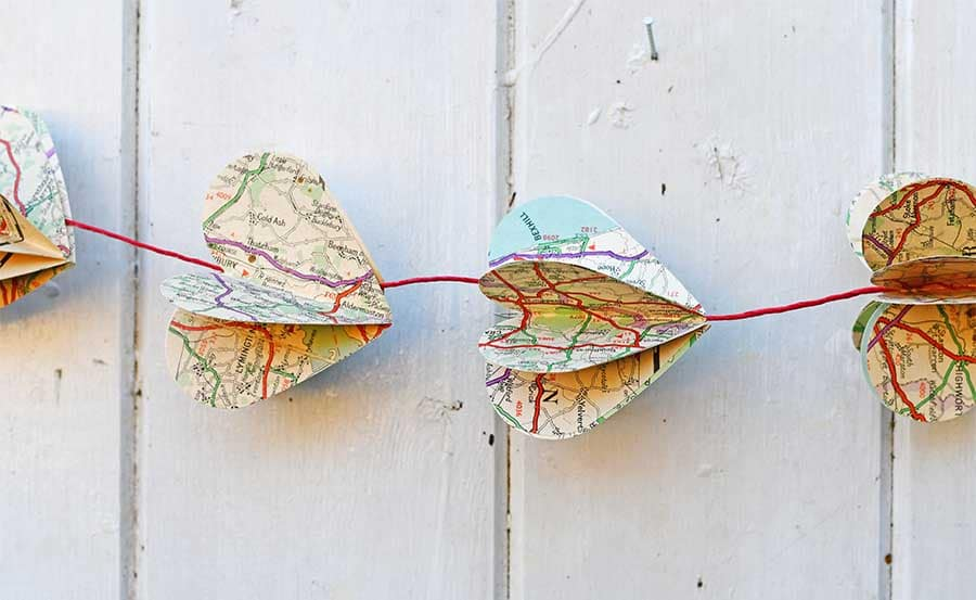 Garland made of paper map hearts.