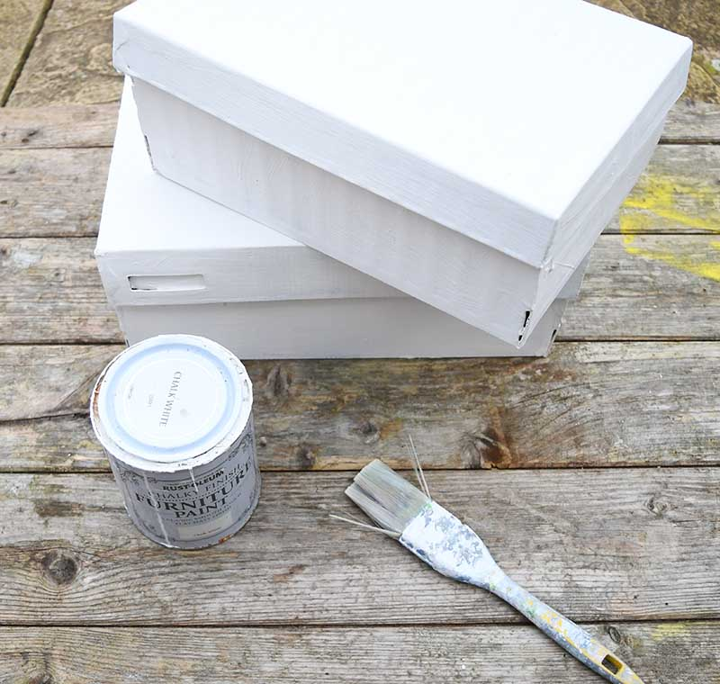 white painted shoe boxes