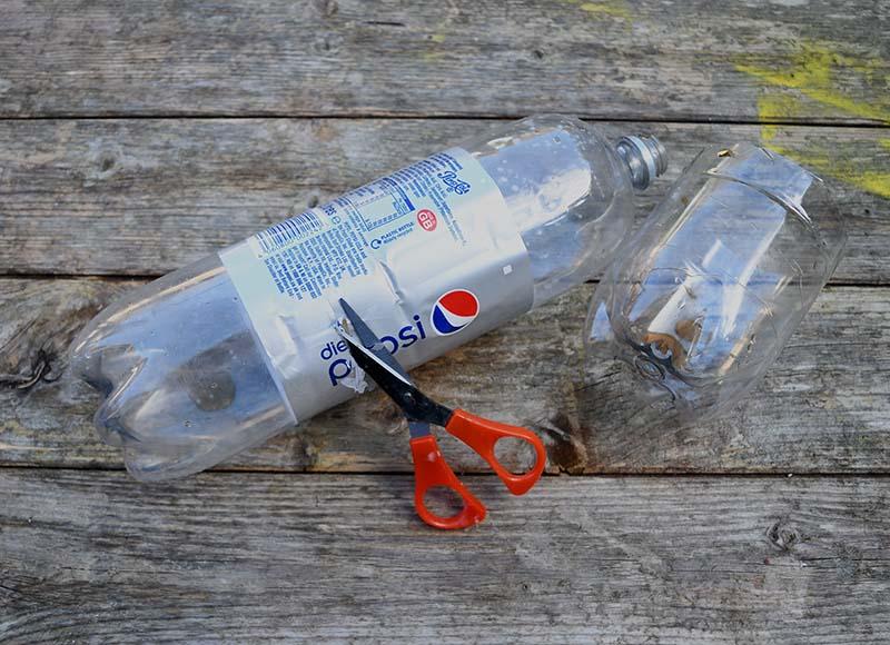 Cutting soda bottles.