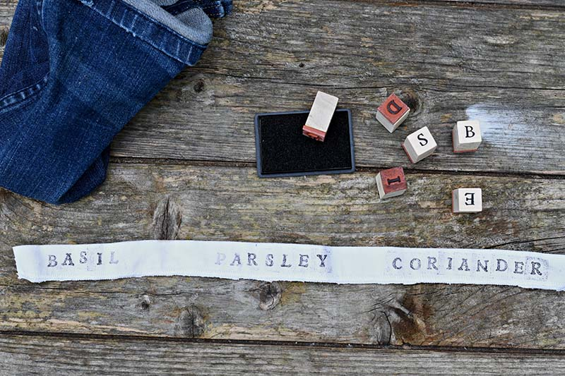 Hand stamped herb labels.