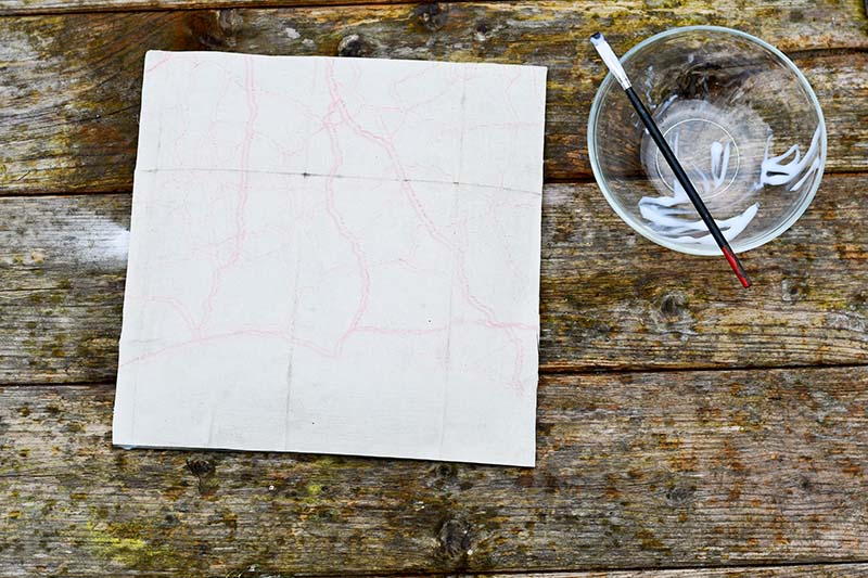 Glueing map to glass tray