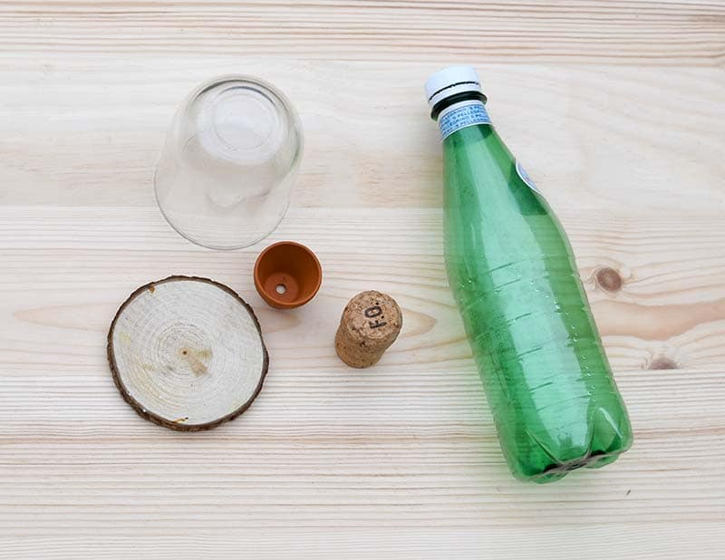plastic bottle, wood slice and nutella jar