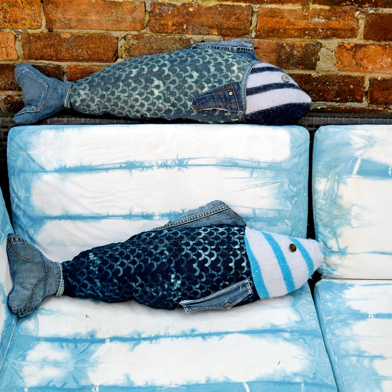 Repurposed denim fish pillows on Shibori dyed sofa.