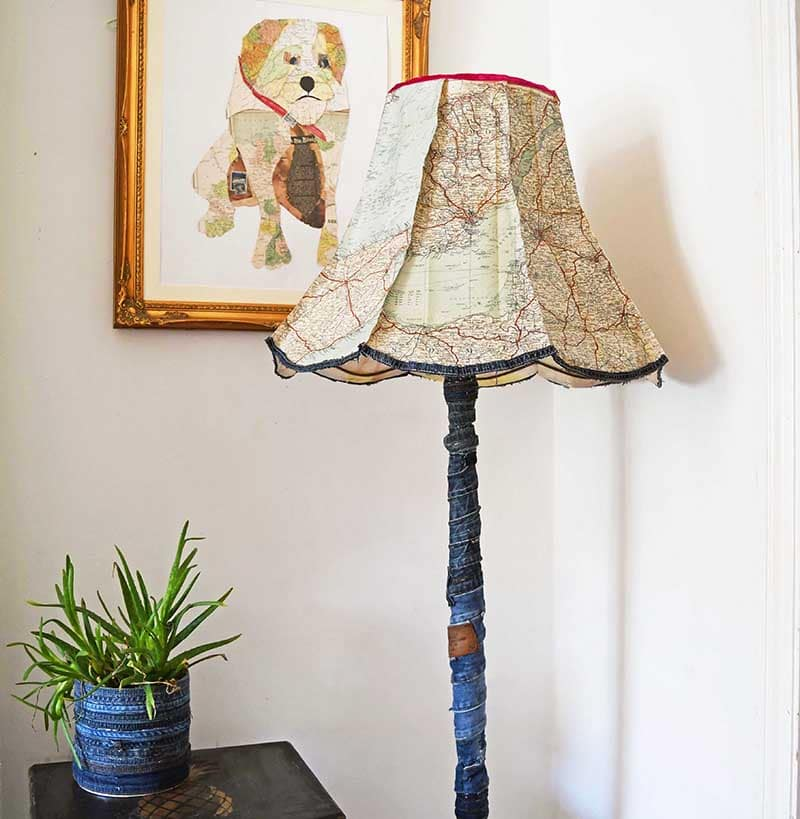Upcycled floor lamp with roadmaps and denim