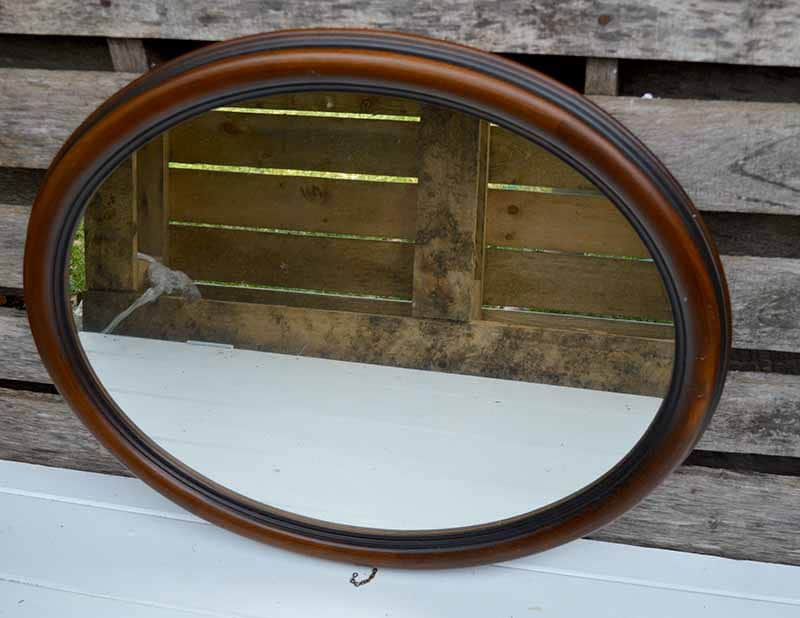 Old oval wall mirror