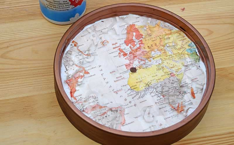 Decoupage map clock with tattoo paper