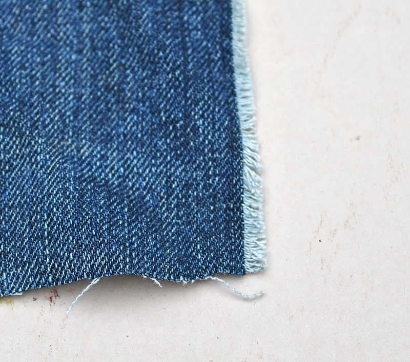 Fraying denim square