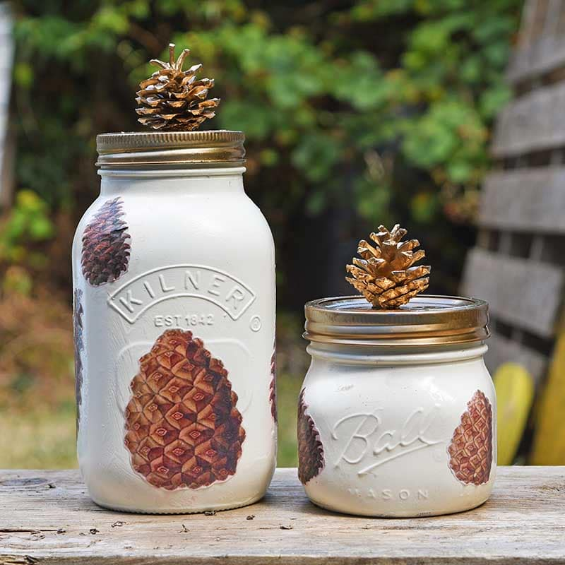 Fall mason jar decorated with pine cones