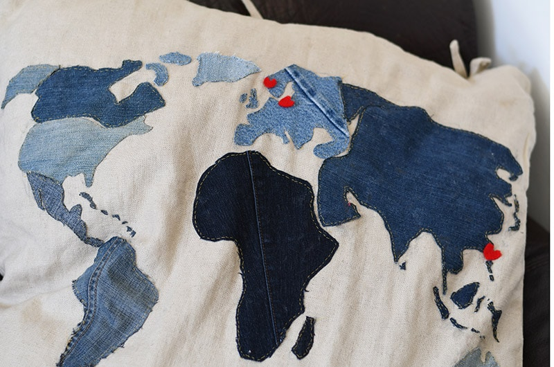 applique denim world map pillow close up