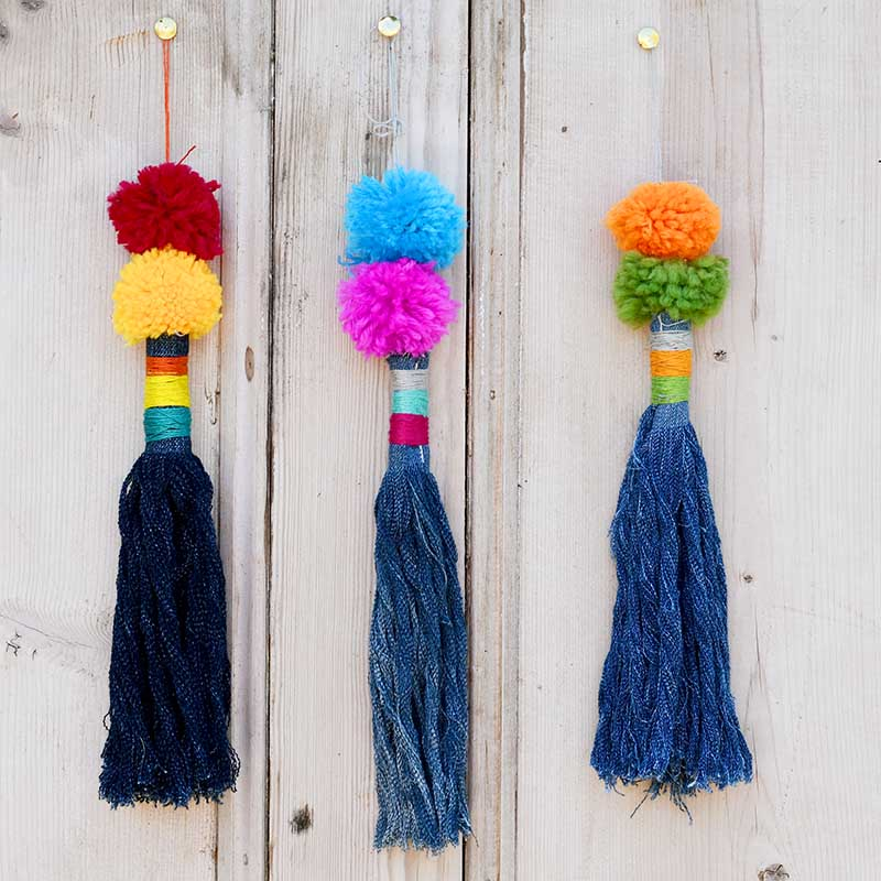Upcycled denim tassels with pom poms